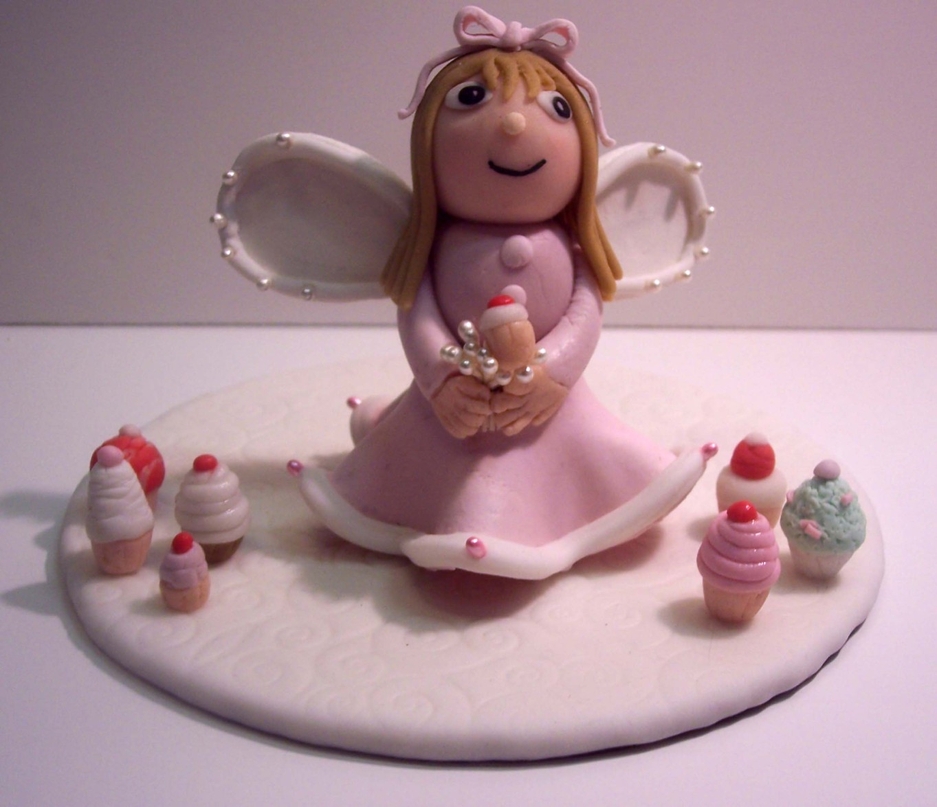 Angel Girl with miniature cupcakes