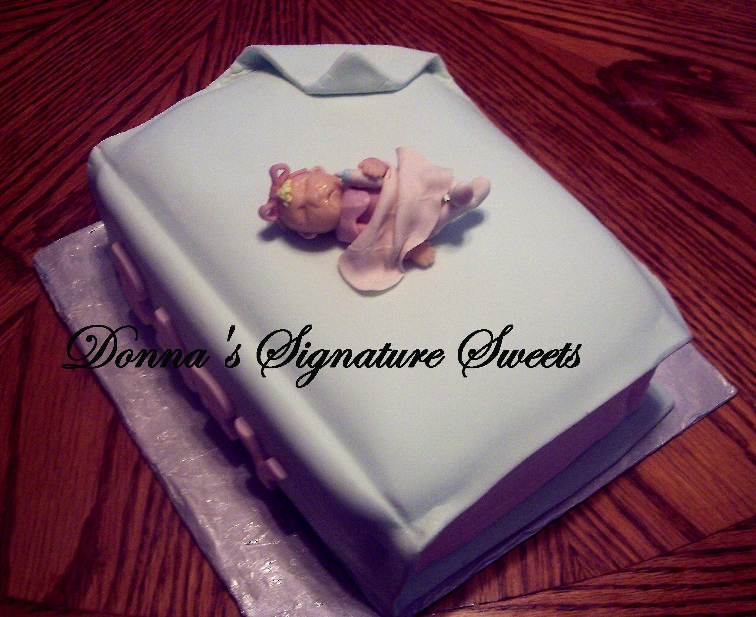 this is a cake that i created for a baby shower i always love