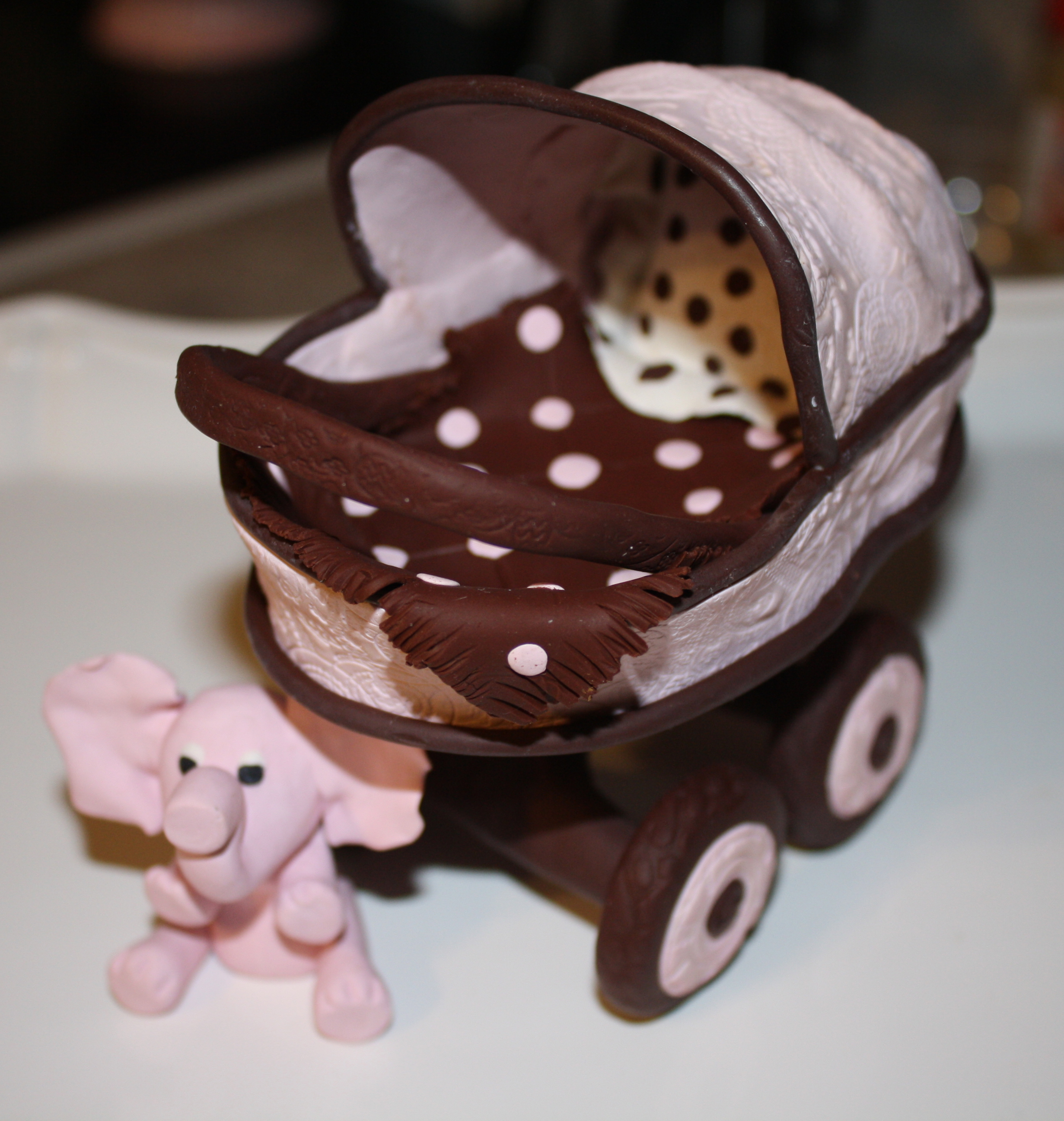 Clay baby carriage cake topper the sugar lane for How to create a baby boy